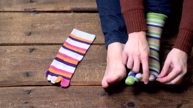 person putting on socks - sock stock videos & royalty-free footage