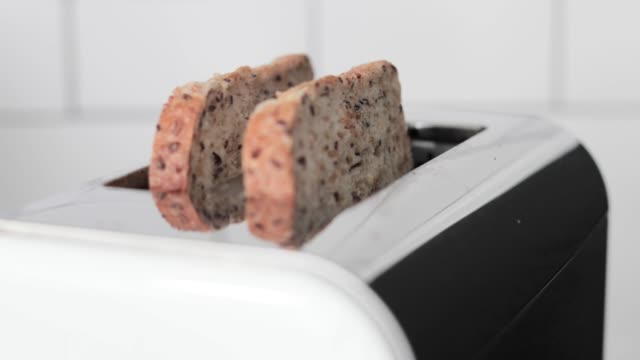person putting piece of bread in toaster - toaster appliance stock videos & royalty-free footage