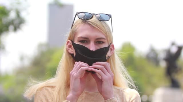person removes a protective mask on april 28, 2020 in mexico city, mexico. mexico in on stage three of health emergency, as deaths and positive cases... - rimuovere video stock e b–roll