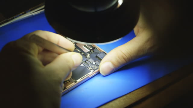 person repairs smartphone, iphone, electronics micro repair - apple computers stock videos & royalty-free footage
