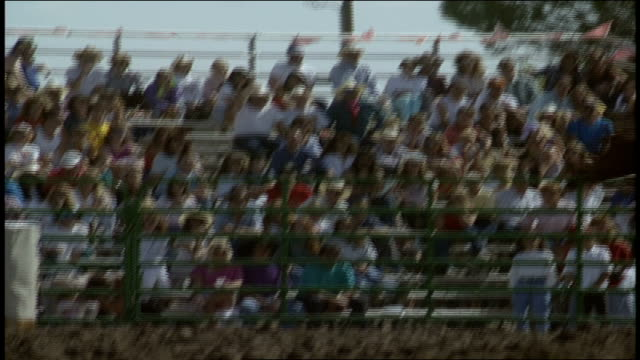 person riding a horse around a barrel at a rodeo - bucking stock videos & royalty-free footage