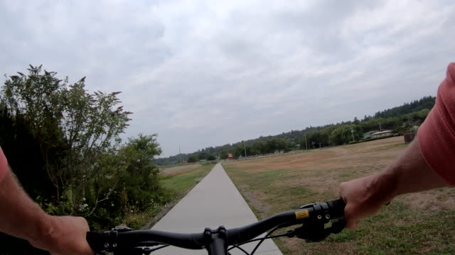pov of person riding bike along sidewalk - only mature men stock videos & royalty-free footage
