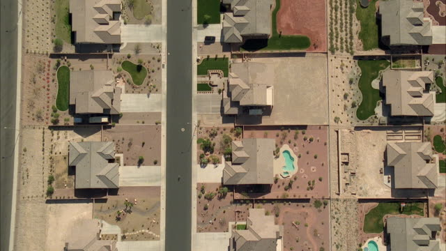 aerial ws ts person riding bike through suburbs / las vegas, nevada, usa - nevada stock videos & royalty-free footage