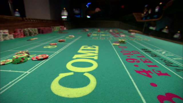 person rolling dice on craps table - dice stock videos & royalty-free footage