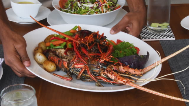 person serving plate of freshly prepared lobster - sri lankan culture stock videos and b-roll footage
