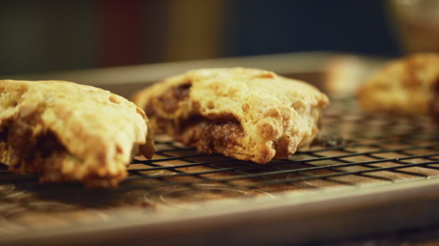 a person sets down a baking tray with homemade scones on to a countertop - tray stock videos & royalty-free footage