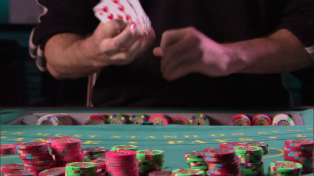 person shuffling cards - one mid adult man only stock videos & royalty-free footage