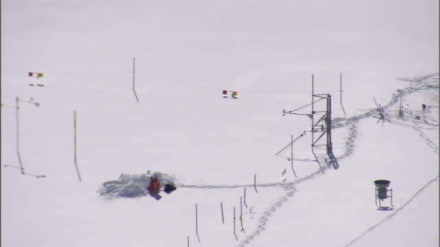a person sits in the center of an avalanche rescue training course. - fence stock videos & royalty-free footage
