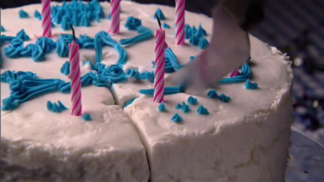 ecu, zo, person slicing  birthday cake  - extreme close up stock videos & royalty-free footage