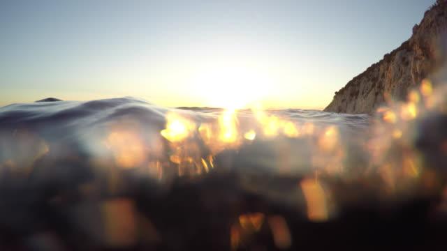 POV Person swimming into the sunset