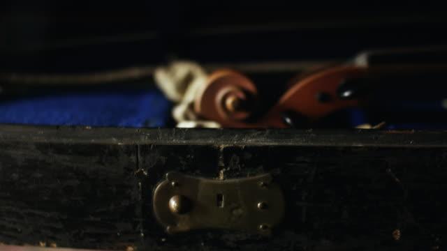 CU Person taken out violin form case / Edinburgh, Scotland, United Kingdom