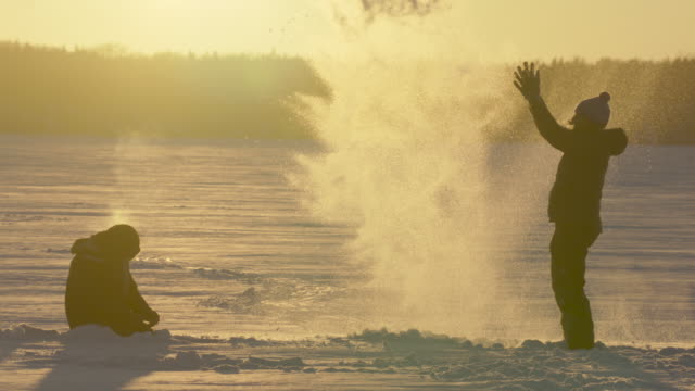 person throws snow into the air at sunset. japan - hokkaido stock videos & royalty-free footage