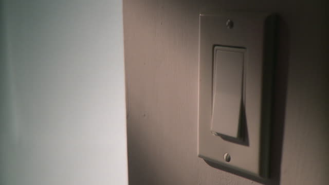 cu person turning light switch on and off, panama city, panama  - light switch stock videos & royalty-free footage