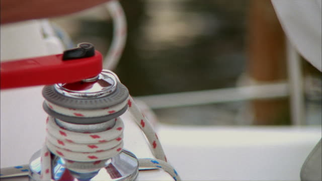 CU, Person turning rope on cable winch in sailboat, Tampa Bay, Florida, USA
