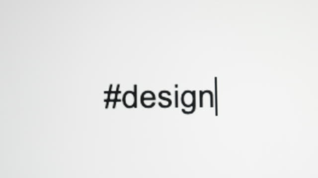 "a person types ""#design"" on their computer screen - graphic designer stock videos & royalty-free footage"