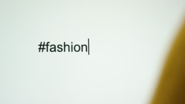 """a person types """"#fashion"""" on their computer screen - haute couture stock videos and b-roll footage"""