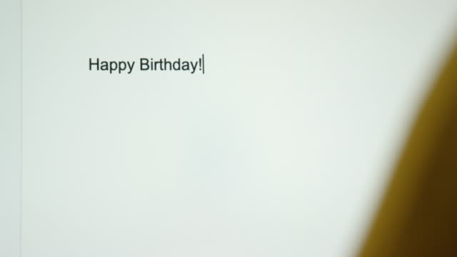 """a person types """"happy birthday!"""" on their computer screen - cards stock videos & royalty-free footage"""