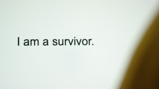 "a person types ""i am a survivor"" on their computer screen - survival stock videos & royalty-free footage"