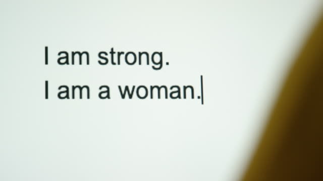 "a person types ""i am strong. i am a woman"" on their computer screen - courage stock videos & royalty-free footage"