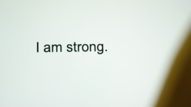 "a person types ""i am strong"" on their computer screen - letter document stock videos & royalty-free footage"