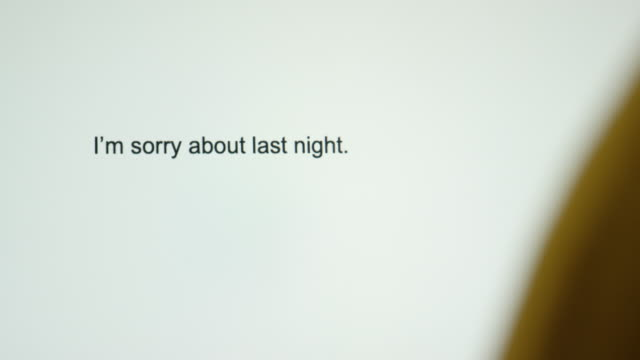 "a person types ""i'm sorry about last night"" on their computer screen - letter stock videos & royalty-free footage"