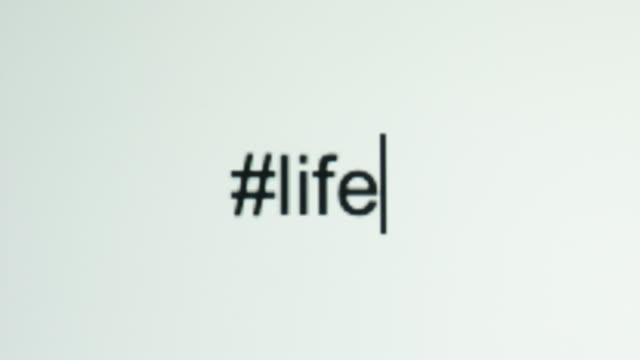 "a person types ""#life"" on their computer screen - typescript stock videos & royalty-free footage"