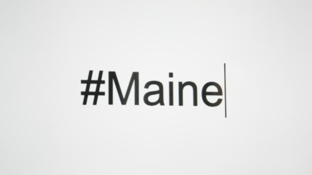 """a person types """"#maine"""" on their computer screen and then follows with the state abbreviation - augusta maine stock videos & royalty-free footage"""