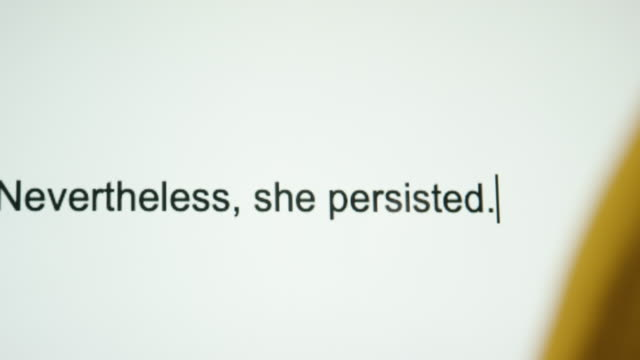 "a person types ""nevertheless, she persisted"" on their computer screen - defending stock videos & royalty-free footage"