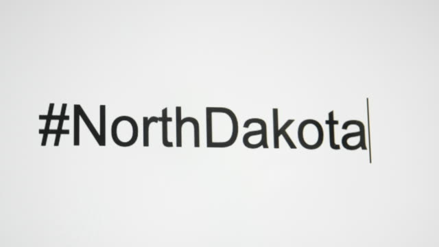 "a person types ""#northdakota"" on their computer screen and then follows with the state abbreviation - bismarck north dakota stock videos & royalty-free footage"