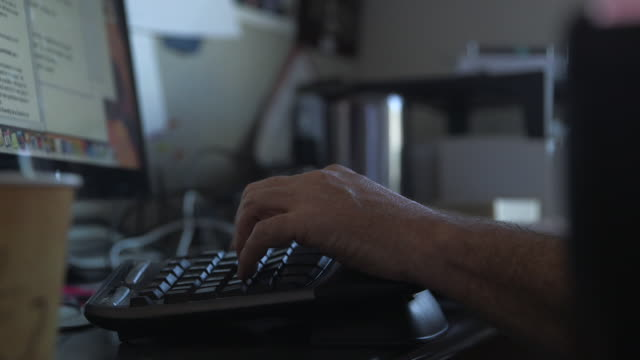 person types on computer keyboard, medium shot - computer keyboard stock videos and b-roll footage