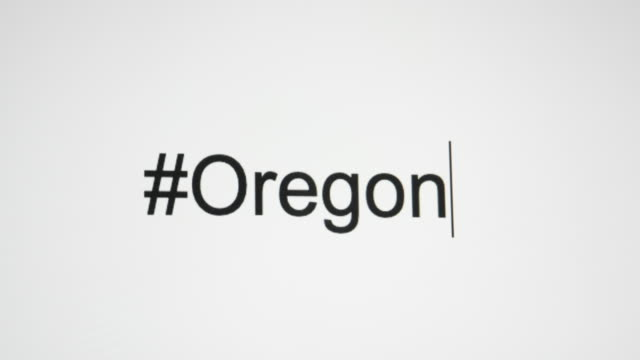 "vídeos de stock e filmes b-roll de a person types ""#oregon"" on their computer screen and then follows with the state abbreviation - salem oregon"