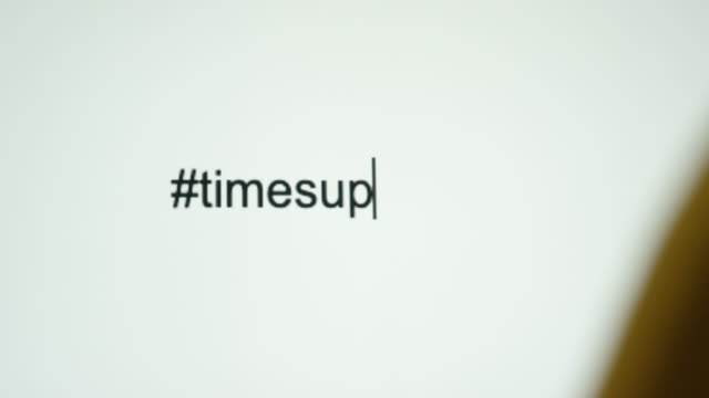"a person types the hashtag ""#timesup"" on their computer screen - abuse stock videos and b-roll footage"