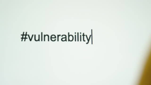 "a person types ""#vulnerability"" on their computer screen - vulnerability stock videos & royalty-free footage"