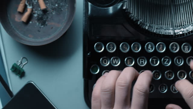 DS person typewriting on an old office desk