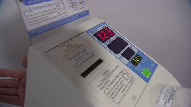 a person undergoing a blood pressure check - スキップトン点の映像素材/bロール