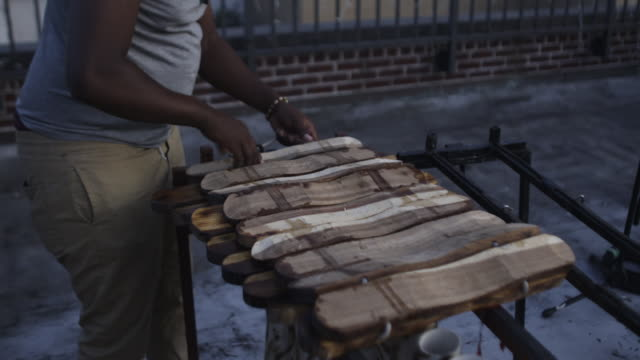 person unpacks homemade marimba - untied stock videos and b-roll footage