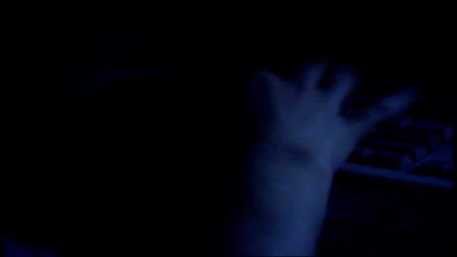 stockvideo's en b-roll-footage met person using a pc desktop at night - 1997