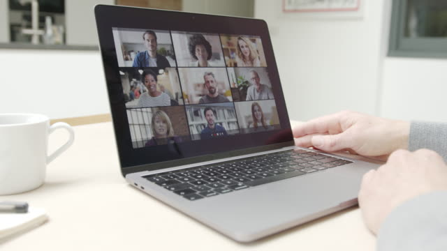 person using video conferencing technology in kitchen for video call with colleagues at home and in offices - employee engagement stock videos & royalty-free footage