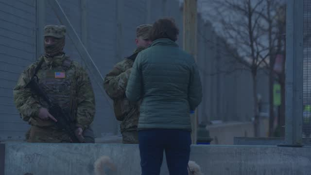 person walking a dog speaks to national guard standing guard at a checkpoint at the u.s. capitol on january 17, 2021 in washington, dc. there are... - three people stock videos & royalty-free footage
