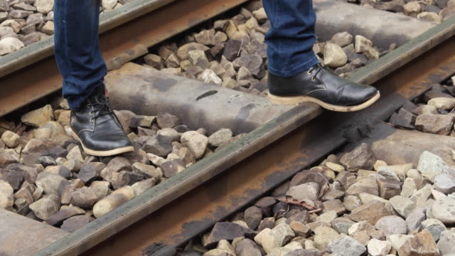 person walking by a railway track - british rail stock videos & royalty-free footage