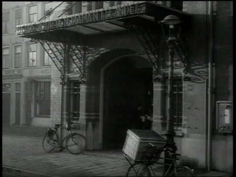 1938 montage person walking into building / amsterdam, netherlands - judentum stock-videos und b-roll-filmmaterial
