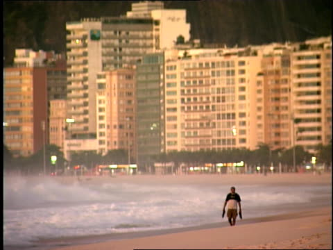 person walking on beachfront lined with tall buildings - see other clips from this shoot 1158 stock videos & royalty-free footage