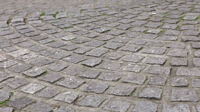 person walking on cobbled street, low section - cobblestone stock videos and b-roll footage