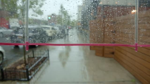 pov person walking on sidewalk umbrella rain - marciapiede video stock e b–roll
