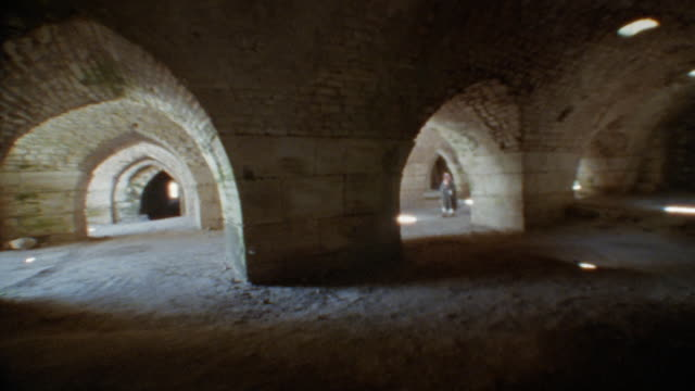 ms, person walking through arched corridors of crac des chevaliers fortress, syria - history stock videos & royalty-free footage