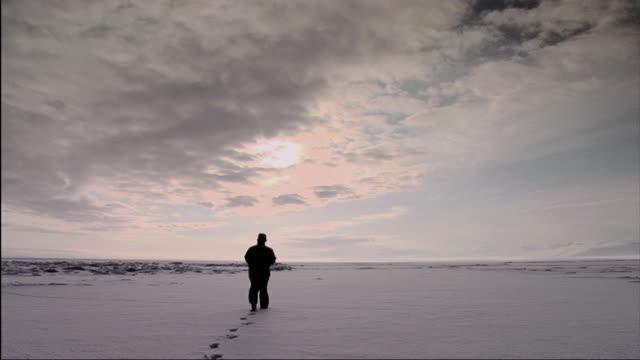 WS Person walking towards distance on frozen Lake Baikal / Irkutsk, Russia