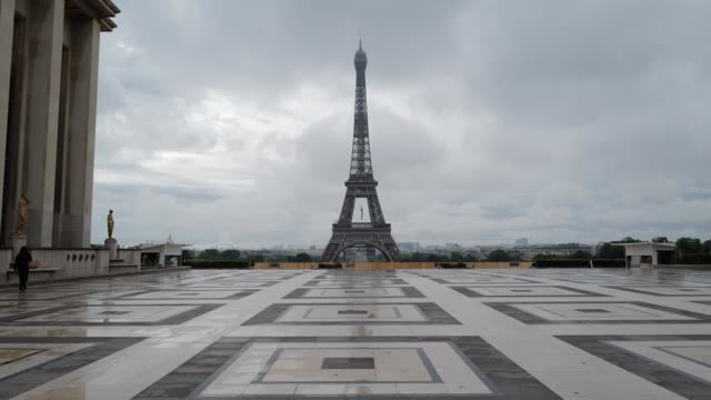 person walks in trocadero square with views of the eiffel tower during the coronavirus pandemic on may 10, 2020 in paris, france. france has has seen... - eiffel tower paris stock videos & royalty-free footage