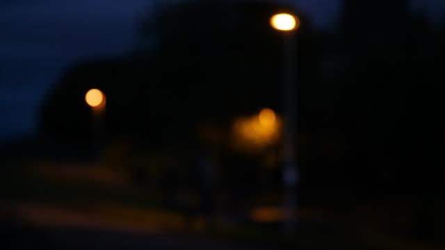 person walks past streetlight at night - edinburgh scotland stock videos & royalty-free footage