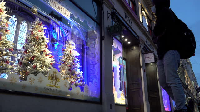 person wearing a face mask stops to look at the christmas window display at hamleys toy store in regent street on november 07, 2020 in london,... - toy stock videos & royalty-free footage