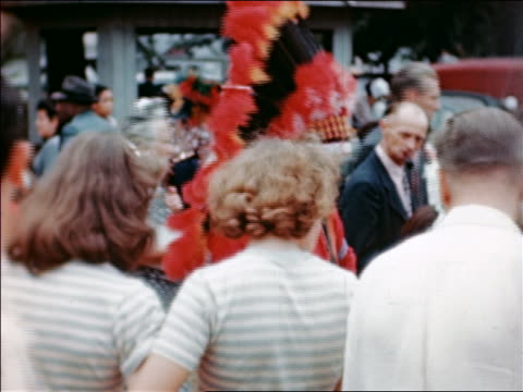 1946 person wearing native american headdress standing in crowd at state fair / industrial /audio - headdress stock videos & royalty-free footage